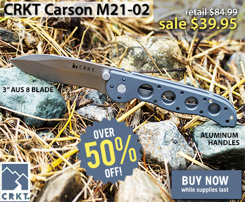 CRKT Carson folding knife on a bed of rocks and brush
