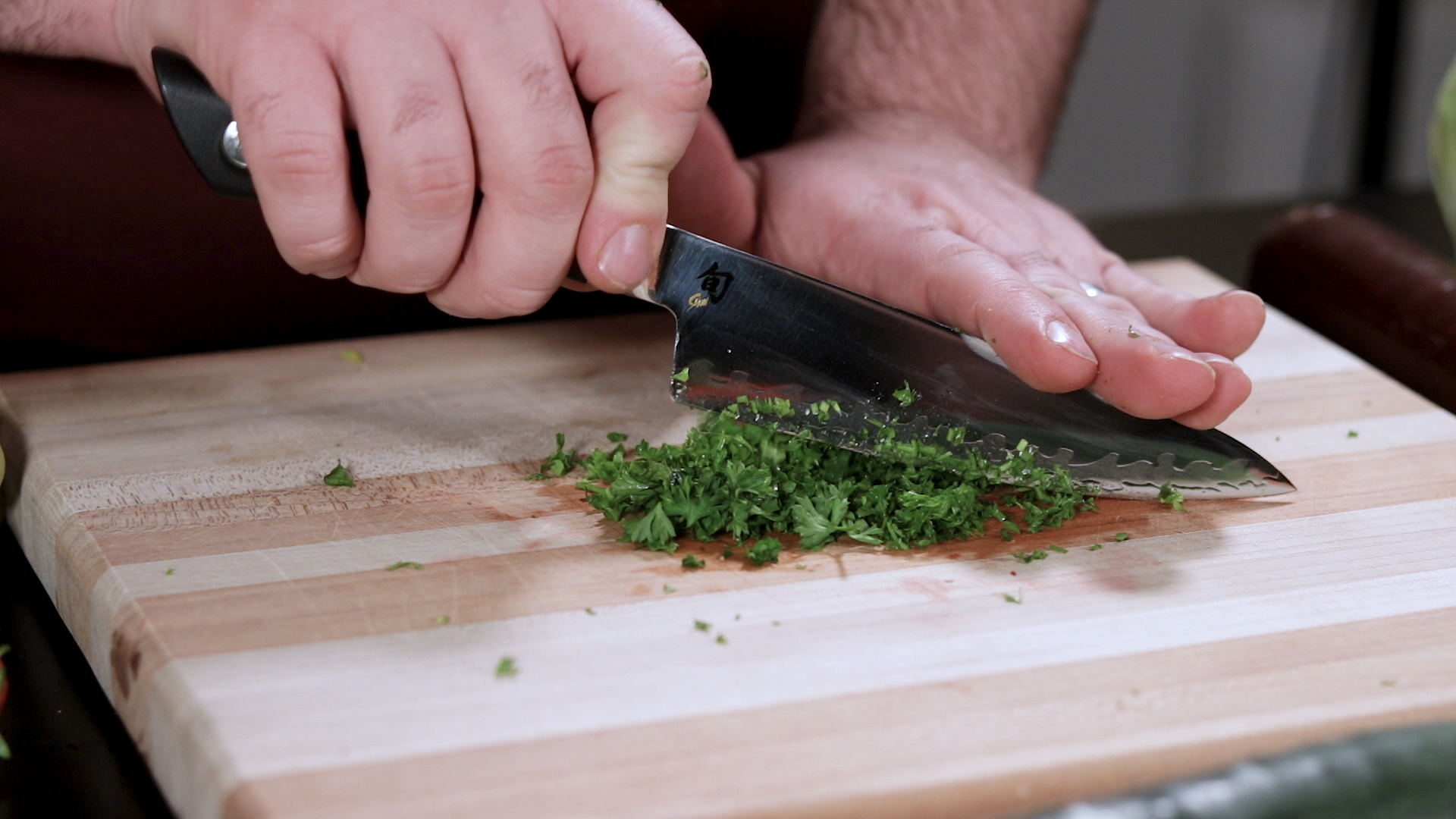 "Shun Sora 6"" Chef Knife Mincing Parsley"