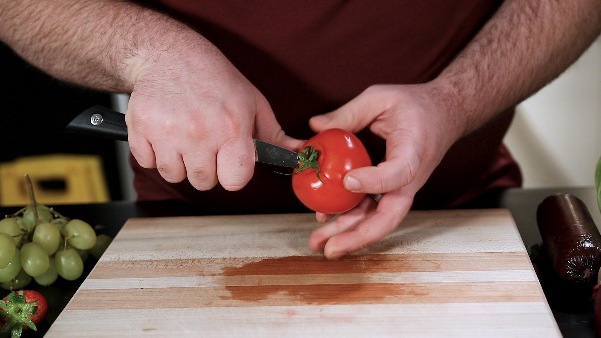 Shun Sora Paring Knife Trimming a Tomato