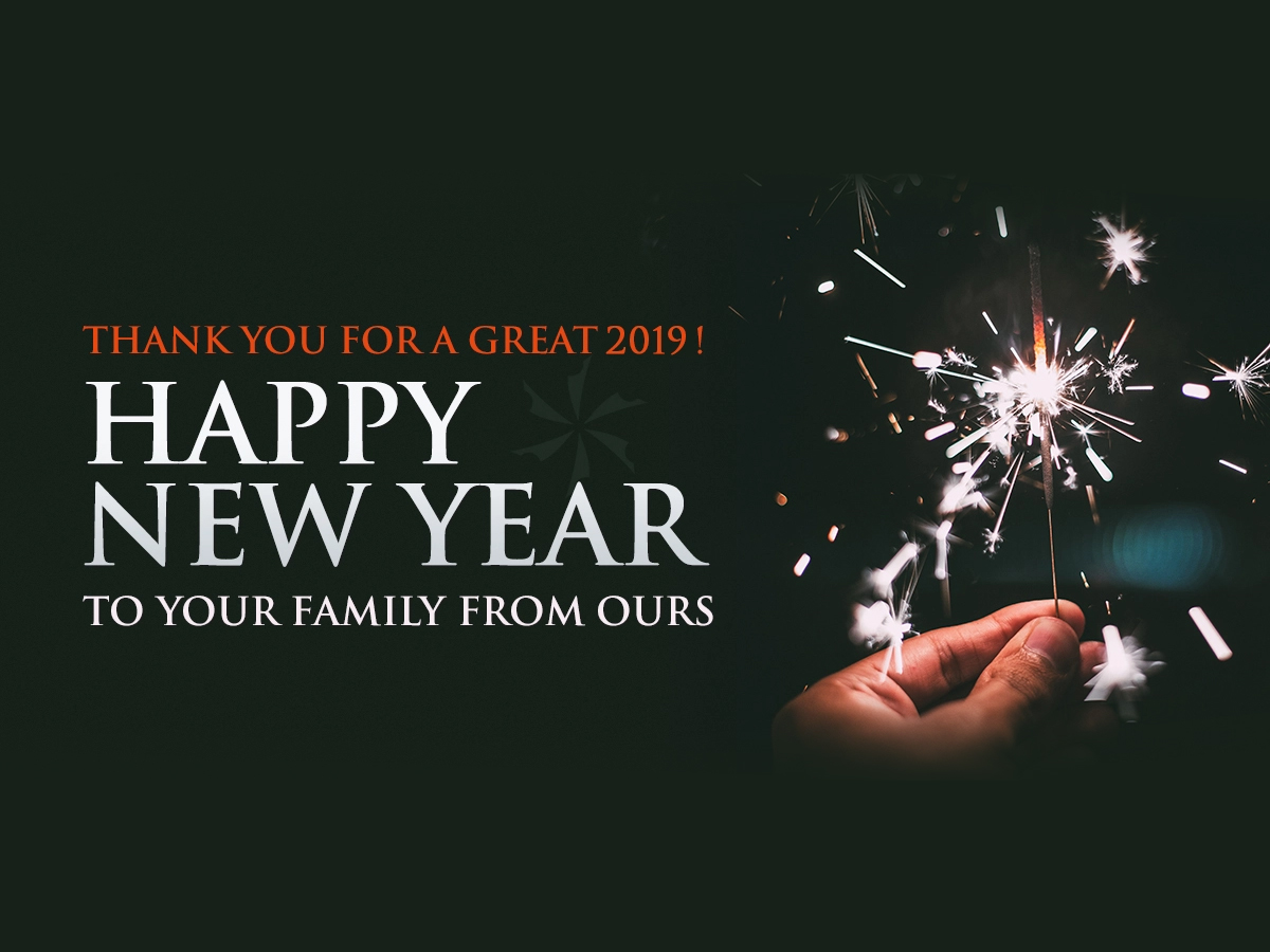 Happy New Year Graphic with hand holding a lit sparkler
