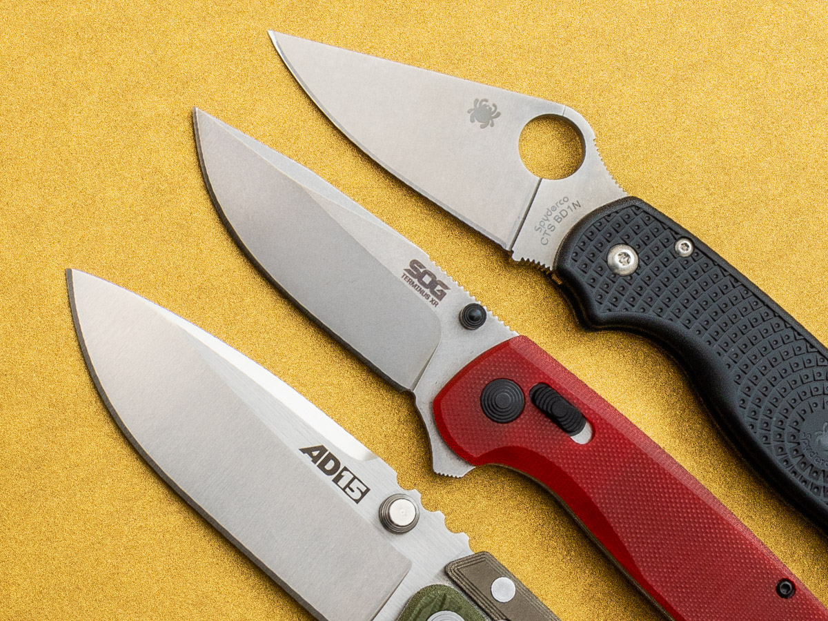 Cropped shot of Cold Steel AD14, SOG Terminus XR, and Spyderco Para 3 LW on a gold background