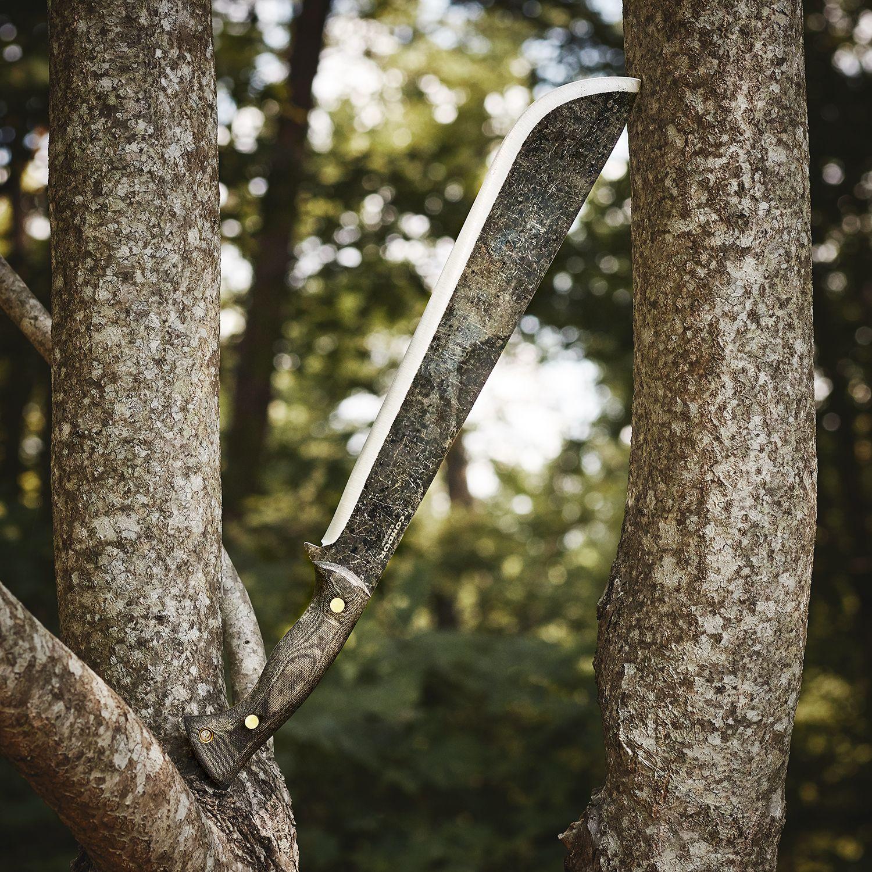 Condor Wastelander Machete against a tree