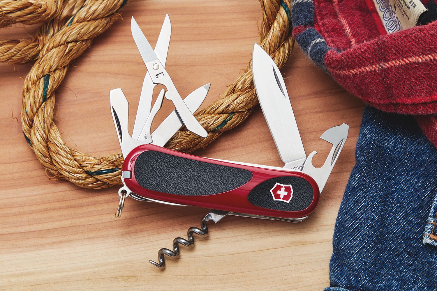 Victorinox Swiss Army Evogrip 14 pocket knife balanced on a coil of rope
