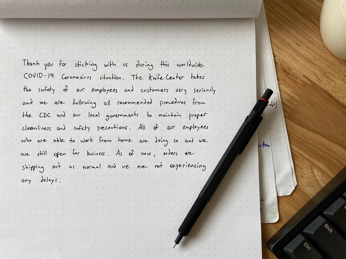 Handwritten letter on wooden desk