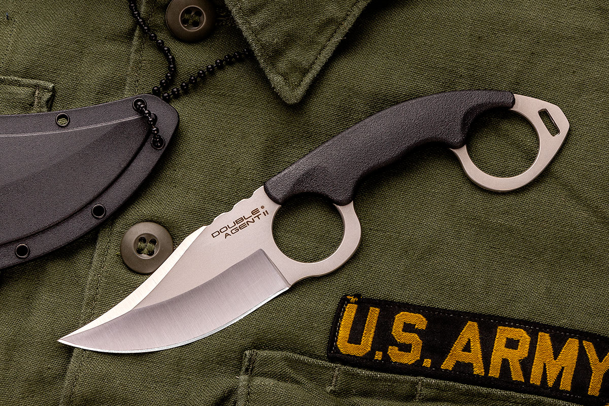 Cold Steel Double Agent II Karambit on top of a U.S. Army uniform