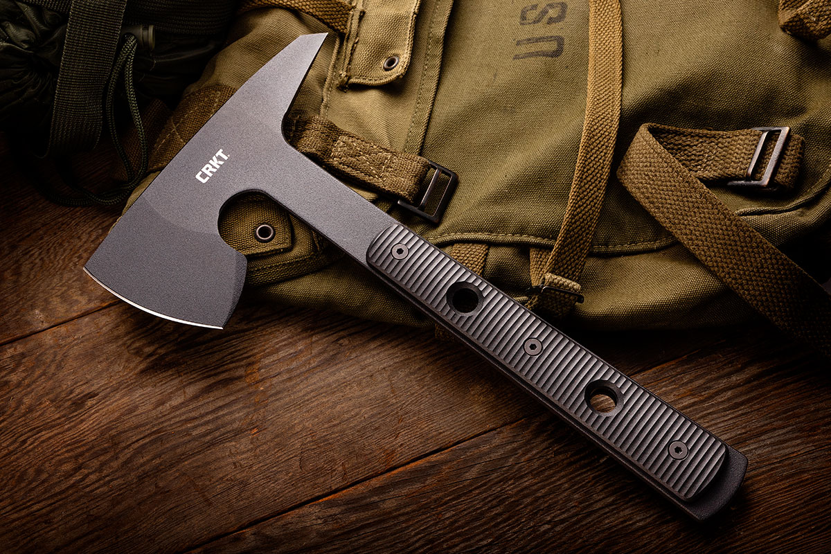 CRKT RMJ Tactical Rune Tomahawk sitting on a canvas rucksack