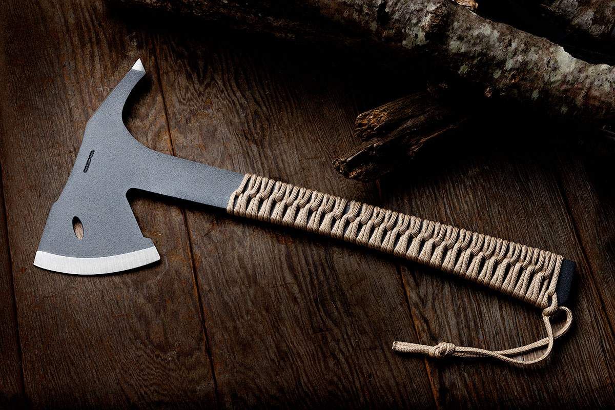 Condor Sentinel Combat Axe on a wood background