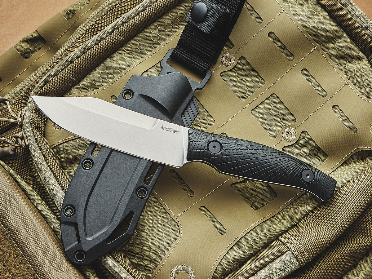Kershaw Camp 5 fixed blade and sheath resting on a backpack