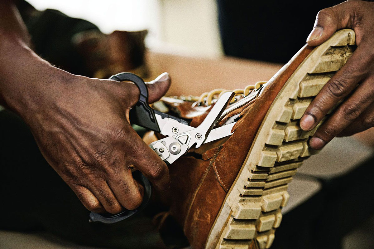 Leatherman Raptor Shears Multi-tool cutting a shoe off a patient's foor