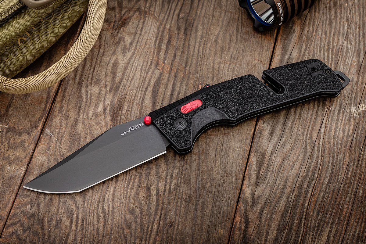SOG Trident AT Tanto on wooden surface