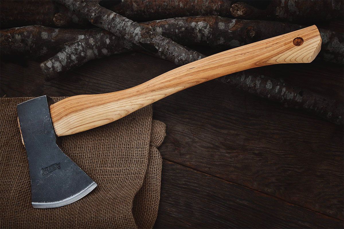 Marble's Camp Axe on burlap and cut branches