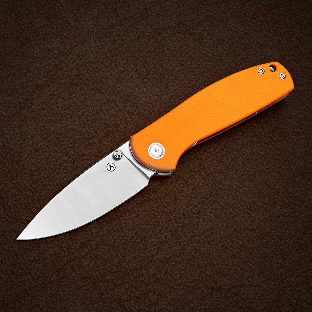 Alliance Designs Jasmine OG folding knife, open on table