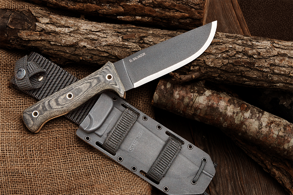 Condor Crotalus fixed blade with sheath on background of logs, wood plank, and burlap