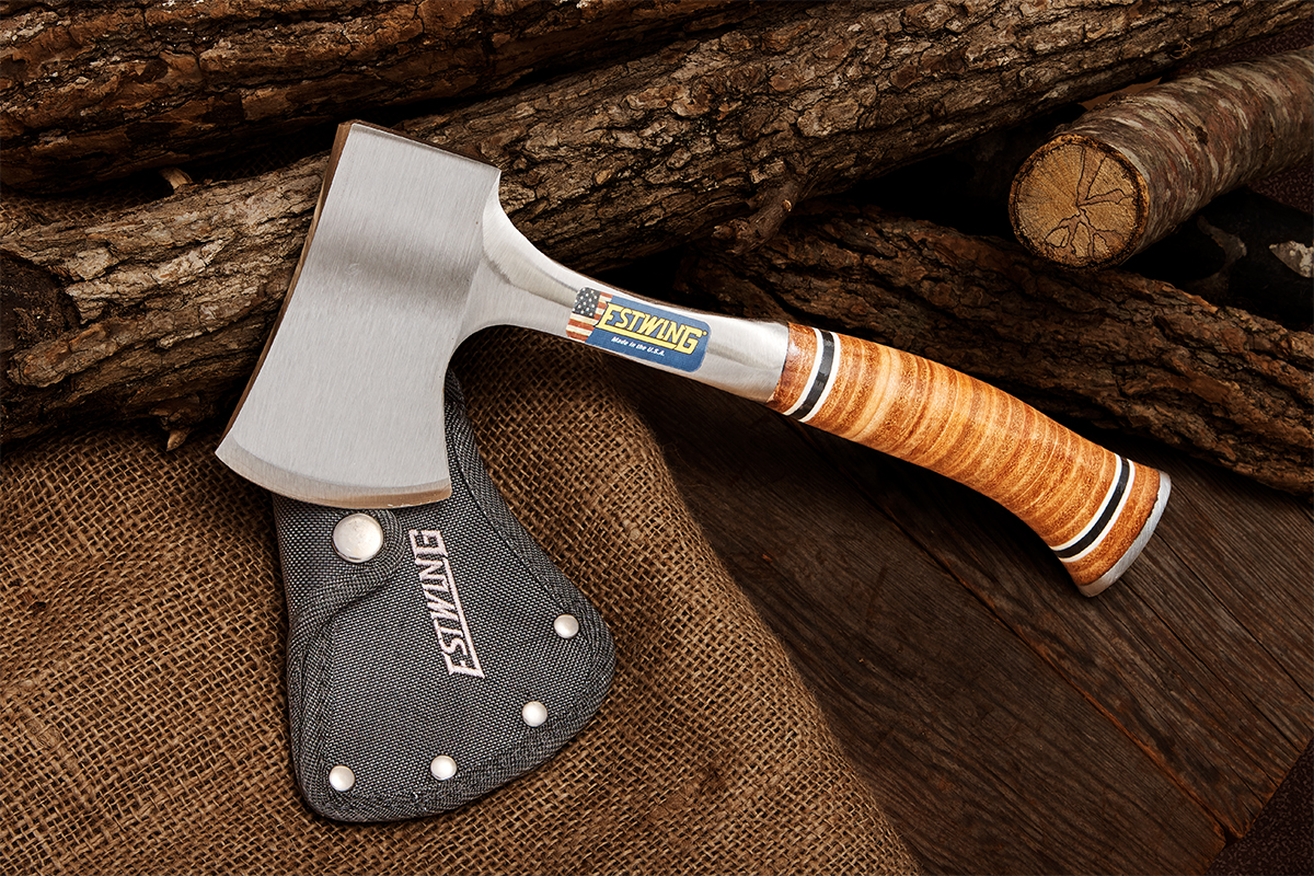 Estwing Sportsman's Axe (hatchet) with blade mask on background of logs, wood plank, and burlap
