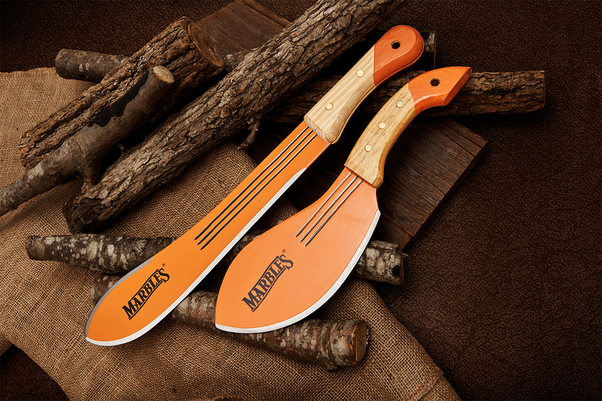 Marble's Bolo machete and Camp Cleaver on background of logs, wood plank, and burlap