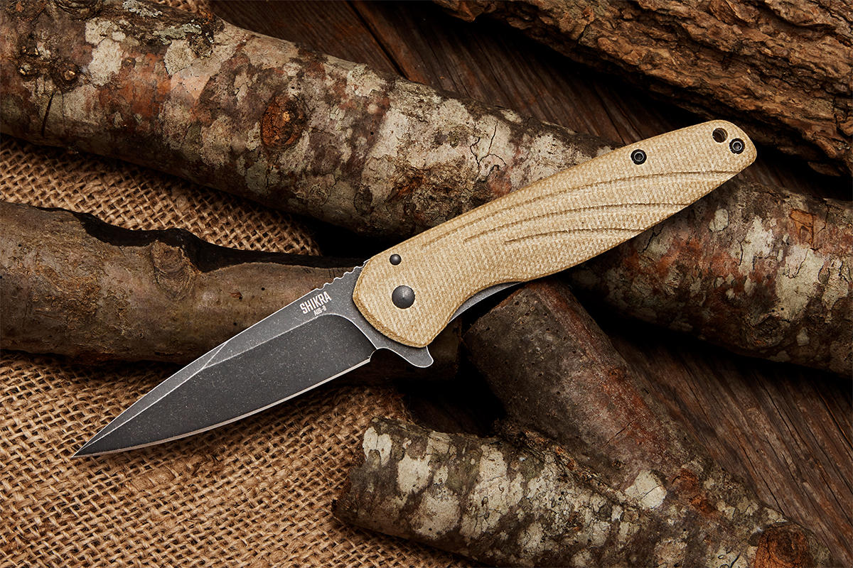 Ontario Shikra flipper open on logs