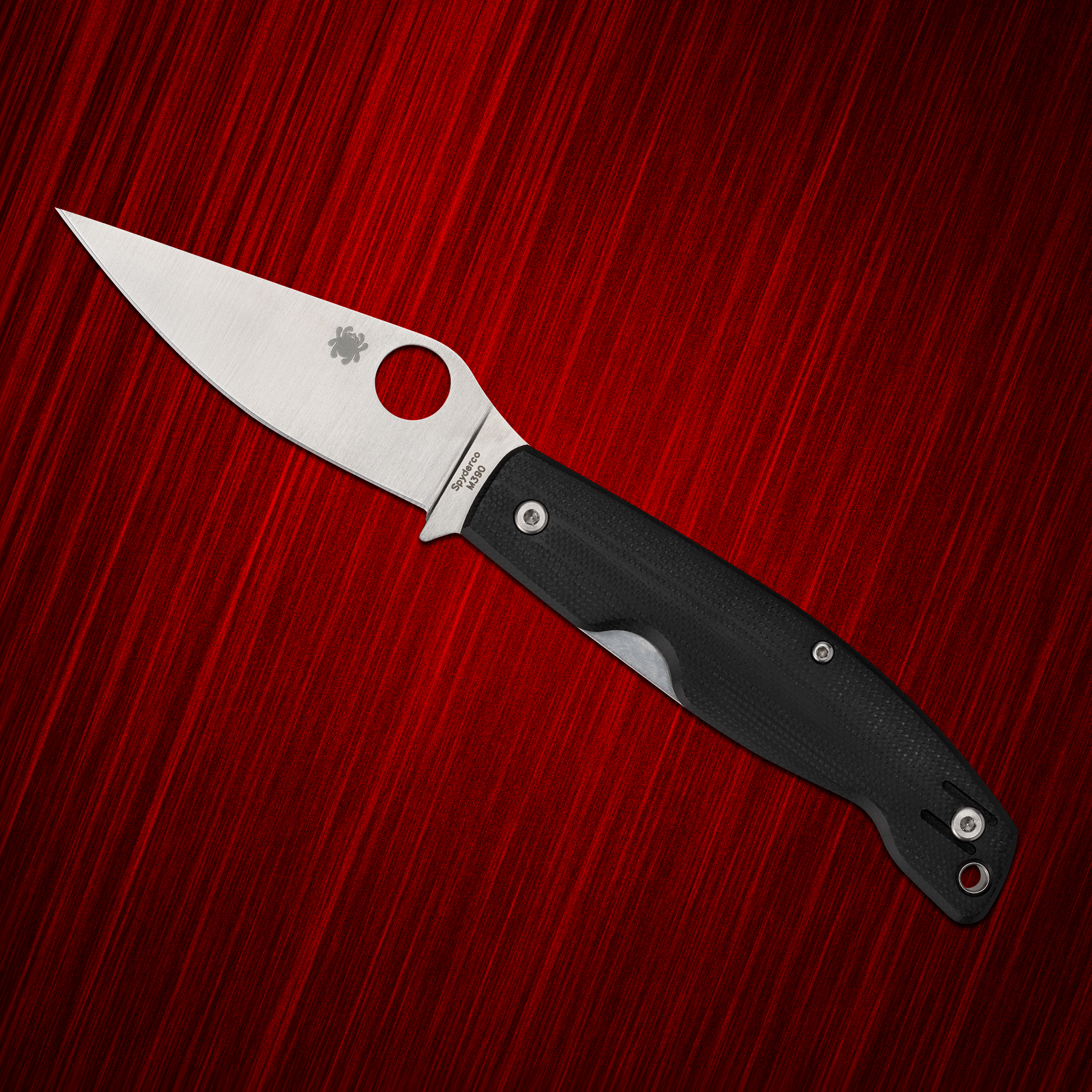 Spyderco Pattadese with black scales on a red background