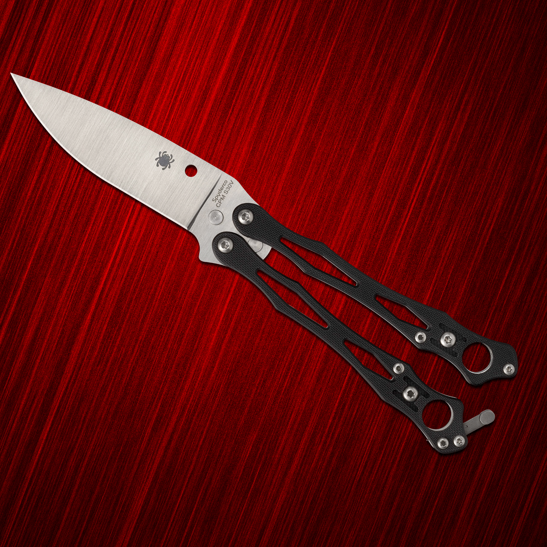 Spyderco Smallfly balisong on a red background