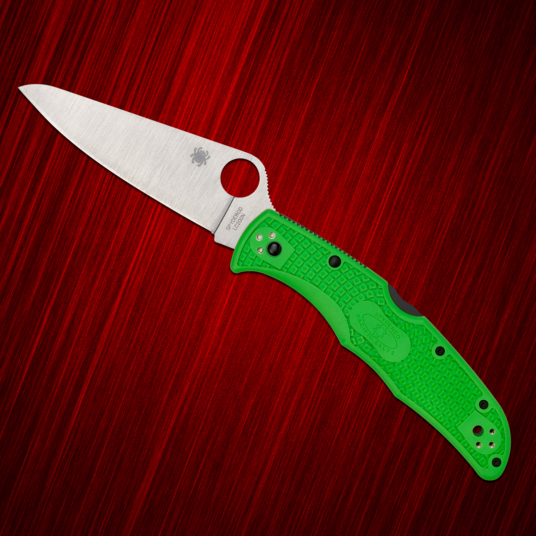 Spyderco Pacific Salt folding knife on a red background
