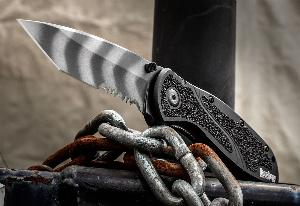 Kershaw Blur Tiger Stripe Tanto Combo Edge on a rusted chain