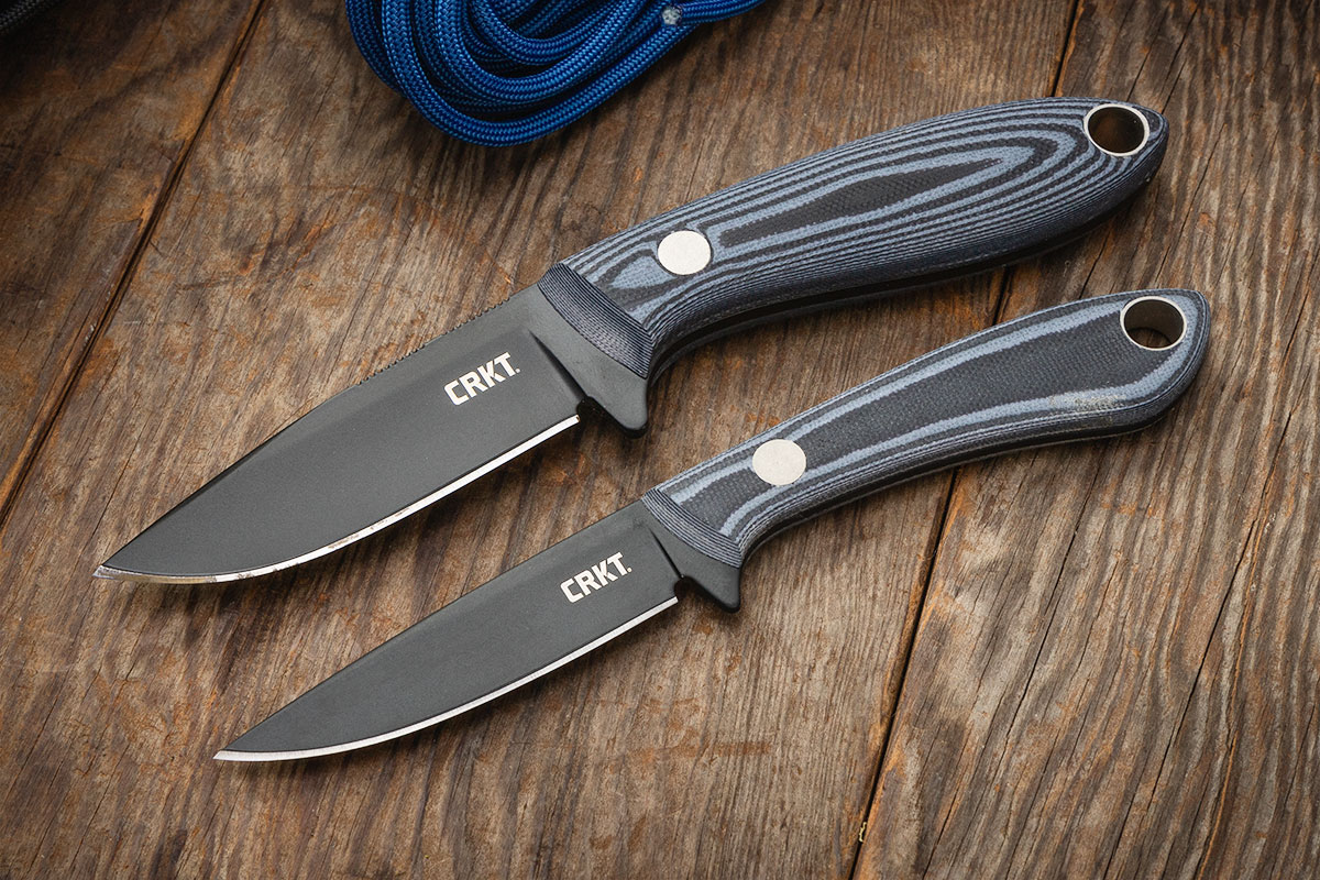 CRKT Mossback Hunter and Mossback Bird and Trout on wood tabletop