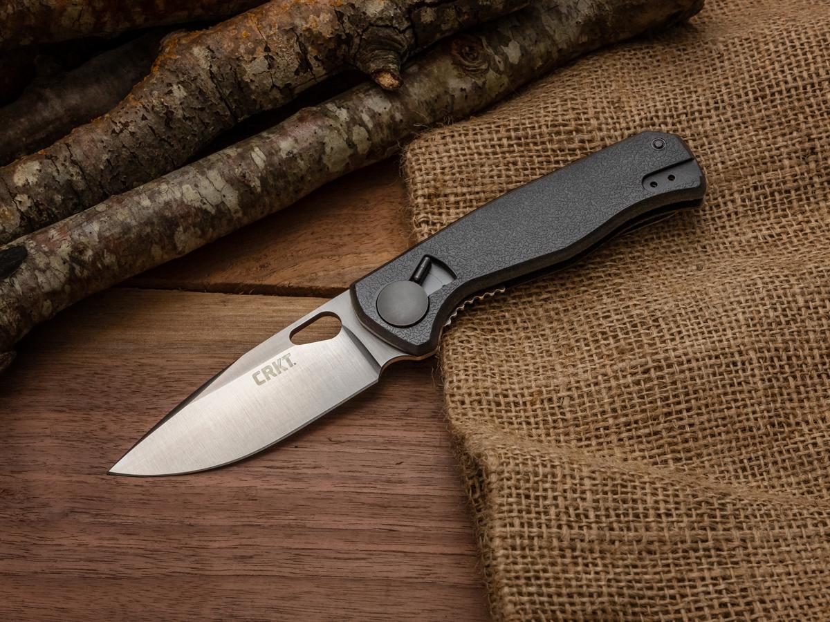 CRKT HVAS folding knife sitting on a burlap bag