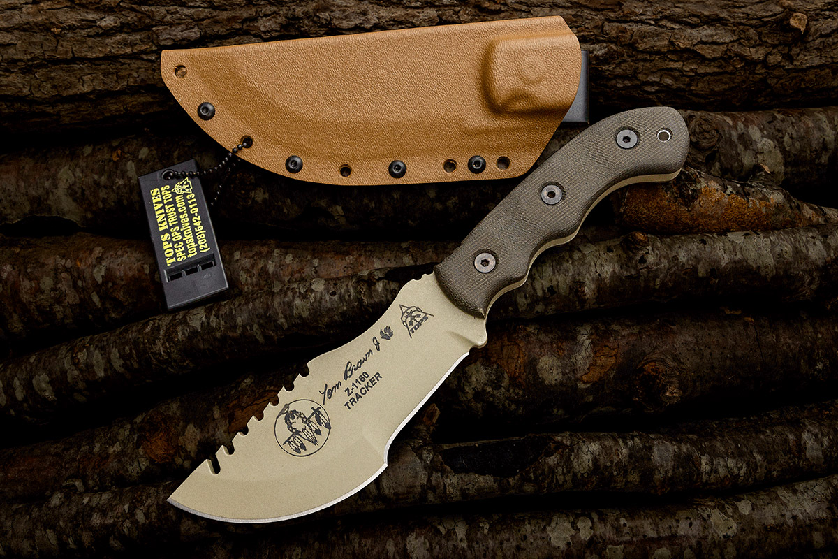 TOPS Tom Brown Tracker knife with sheath on wood pile