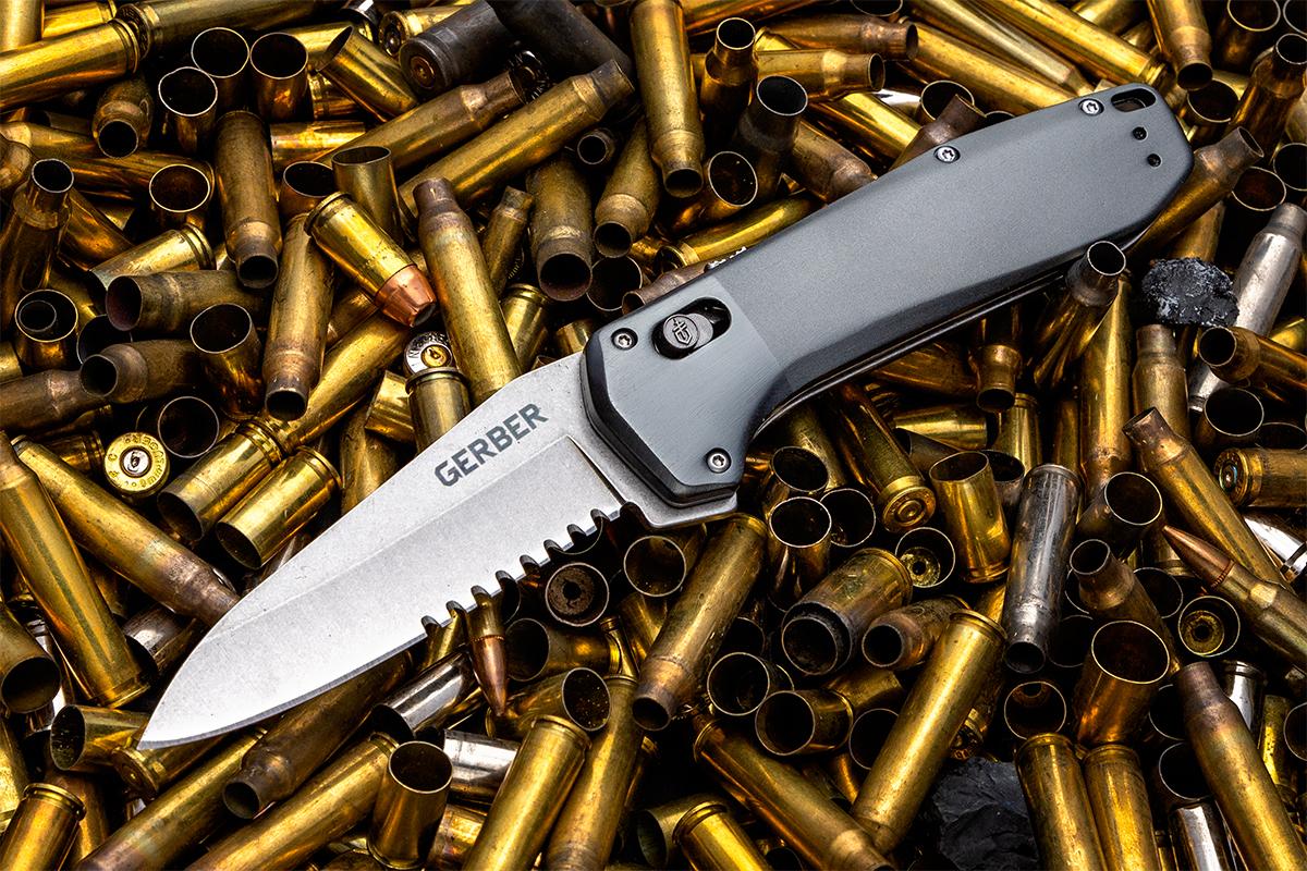 Gerber Highbrow knife open on spent shell casings