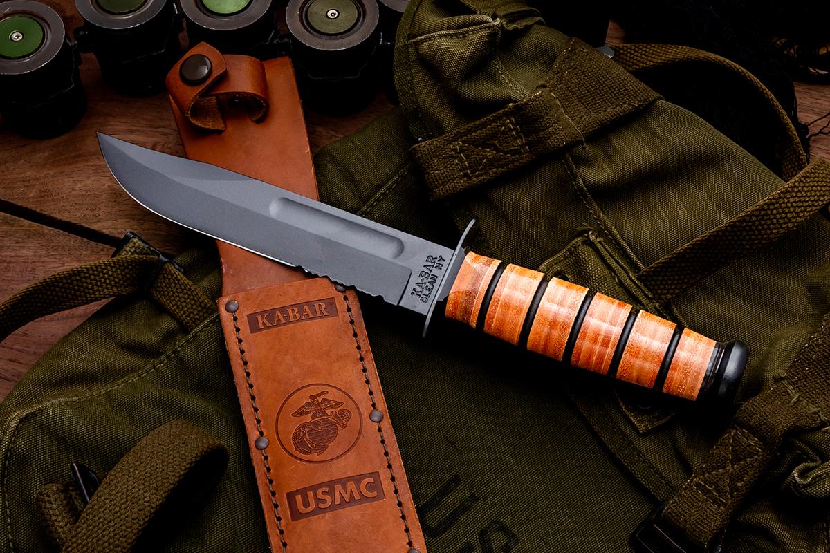 KA-BAR 1218 Fighting Knife resting on its sheath